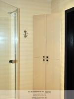 Угловой шкаф в ванную из МДФ  бежевый глянец.Фото